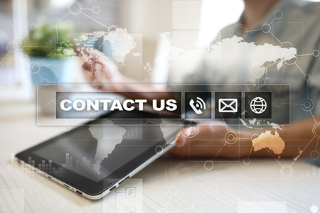 Contact us button and text on virtual screen. Business and technology concept. Stock Photo - 85761474