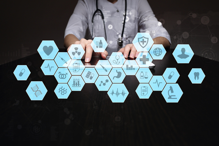 Medical doctor working with modern computer virtual screen interface. Medicine technology and healthcare concept. EMR, EHR, Electronic Health Records. Stock Photo