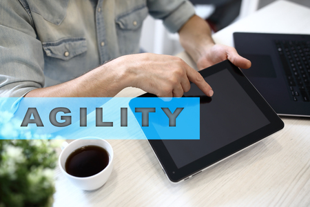iterative: Agility text on virtual screen. Business technology and internet concept.  Stock Photo