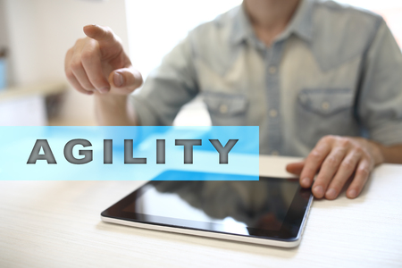 scrum: Agility text on virtual screen. Business technology and internet concept.  Stock Photo