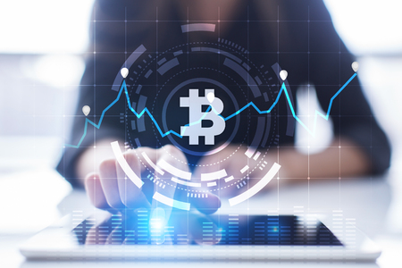Cryptocurrency graph on virtual screen. Business, Finance and technology concept. Bitcoin, Ethereum.