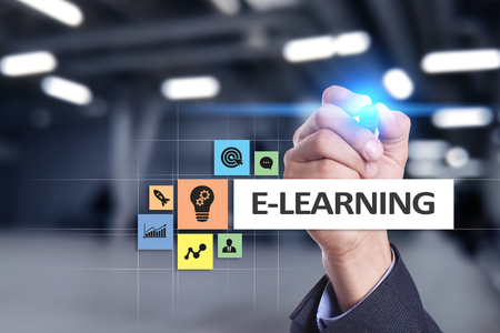 E-Learning on the virtual screen. Internet education concept. Stock Photo