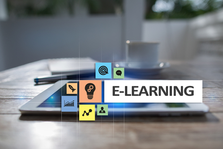 E-Learning on the virtual screen. Internet education concept. 写真素材
