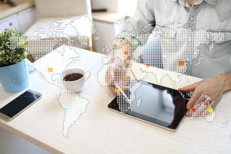 Worlds maps on virtual screen. Business, internet and technology concept.