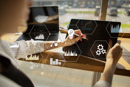 Applications icons and graphs on virtual screen. Business, internet and technology concept. Foto de archivo