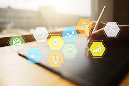 仮想画面上の色付きのアプリケーションのアイコンとグラフ。ビジネス、インターネット、テクノロジーのコンセプト。 写真素材 - 97984880