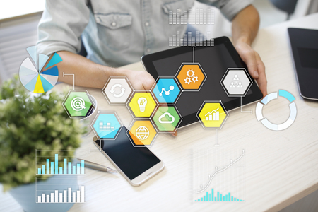 Colored applications icons and graphs on virtual screen. Business, internet and technology concept. Stock Photo