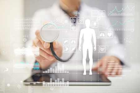 Doctor using modern computer with Medical record diagram on virtual screen concept. Health monitoring application.