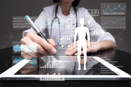 Doctor using modern computer with Medical record diagram on virtual screen concept. Health monitoring application. Standard-Bild - 99641206