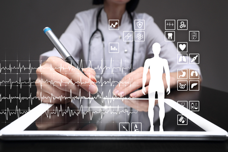 Medical record diagram on virtual screen concept. Health monitoring application. Stock Photo