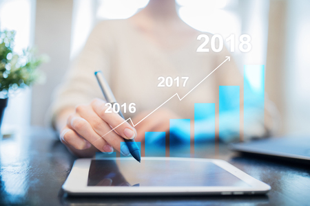2018 year profit growth chart, Business, finance and investment concept on virtual screen. Goals setting on improvement.