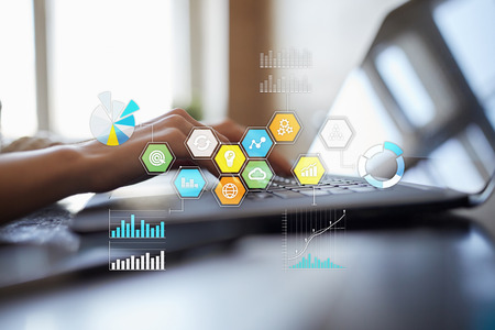 Colored applications icons and graphs on virtual screen. Business, internet and technology concept. Stockfoto