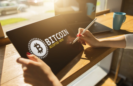 Bitcoin accepted here sign on screen. E-payment, Cryptocurrency and financial technology concept. Stock Photo