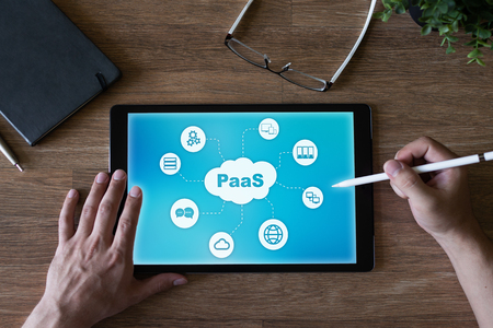 PaaS - Platform as a service. Technology and internet concept on screen.