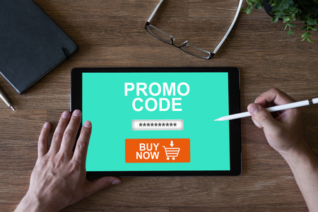 Tablet with promo code field on screen. E-commerce, mobile marketing concept.