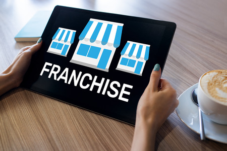 Franchise business model and growth concept on device screen.