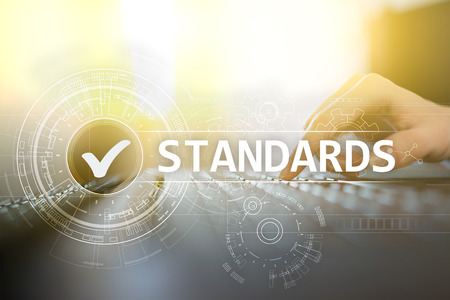 Standards, Quality Control, Assurance, ISO, Checkbox on virtual screen. Stock Photo