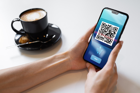 QR code mobile phone scan on screen. Business and technology concept. Stok Fotoğraf