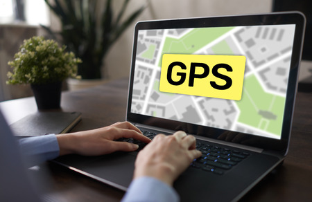 GPS Global Positioning System, Worldwide navigation and tracking concept with town maps on screen. Foto de archivo