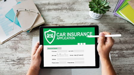 Car insurance application form on screen. Internet and business concept. Reklamní fotografie