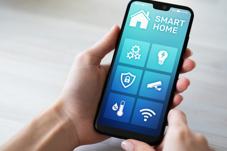 Smart home control application on mobile phone screen. Automation and iot concept.
