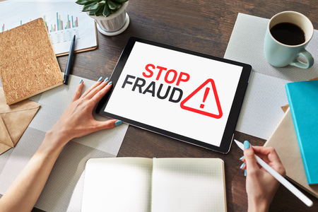 Stop Fraud banner on screen. Cybercrime and internet security concept.