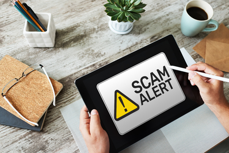 Scam alert detecting warning. Notification on device screen.