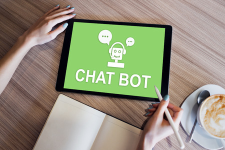 Chatbot icon on device screen. Customer Support automation concept.