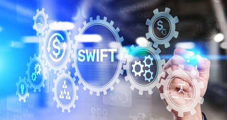 SWIFT international payment system financial technology banking and money transfer concept on virtual screen. Stock Photo