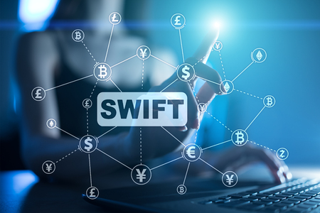 SWIFT, Society for Worldwide Interbank Financial Telecommunications, online payment and financial regulation concept. Stock Photo
