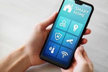 Smart home control application on mobile phone screen. Automation and iot concept