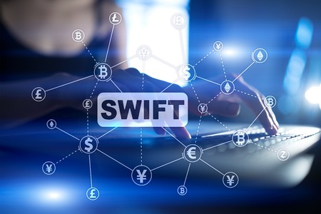 SWIFT, Society for Worldwide Interbank Financial Telecommunications, online payment and financial regulation concept. 写真素材