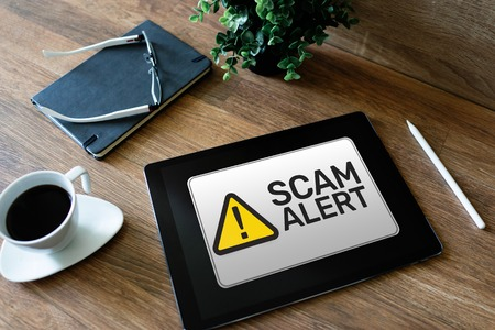 Scam alert detecting warning. Notification on device screen Stock Photo - 121163232