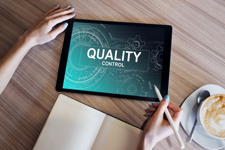Quality control concept on device screen. Business and technology concept. Foto de archivo