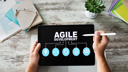 Agile development concept on the device screen.