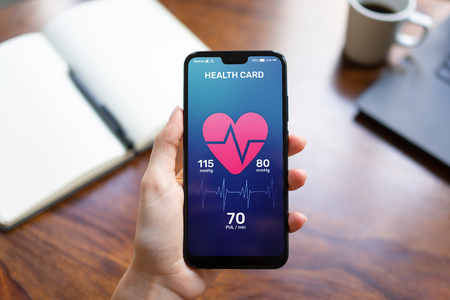 Health control application on smartphone with pulse and arterial pressure control. Concept of modern medical technology.