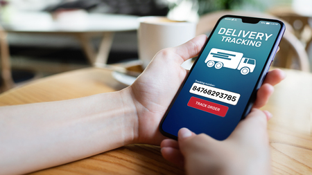 Delivery tracking application form on mobile phone screen. Business and service concept.