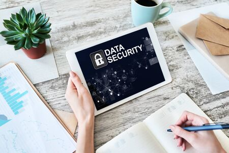 Data security, cyber protection, information privacy concept on device screen.