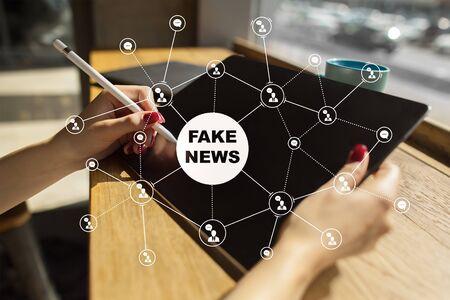 Fake news warning on the virtual screen. Imagens