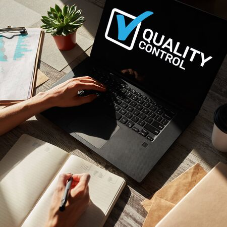 Quality control check box on device screen. Standards and certification, assurance, guarantee. Business technology industrial concept.