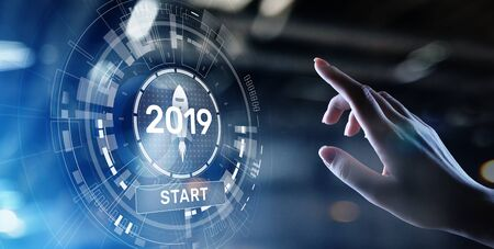 New year 2019 start button on virtual screen hologram. FInancial growth and new perspective in business and life. Imagens