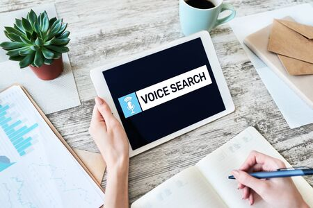 Voice search application on device screen. Internet and technology concept. Banco de Imagens