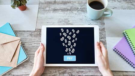 Bitcoin payment accepted on device screen, cryptocurrency, blockchain. Banco de Imagens