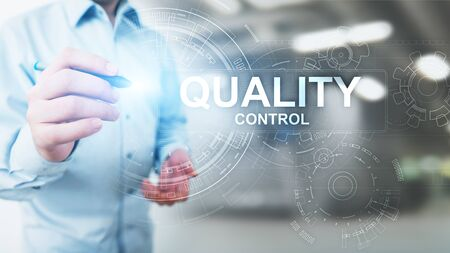 Quality control, assurance, industry standards concept on virtual screen. Banco de Imagens