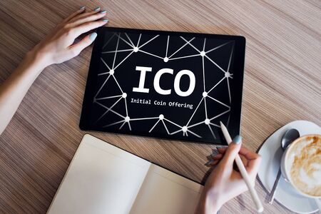 ICO - Initial coin offering. Blockchain and financial technology concept. Banco de Imagens