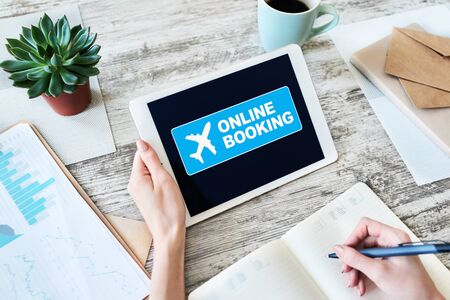 Flight ticket booking online service on device screen. Internet and technology concept.