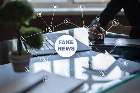 Fake news warning on the virtual screen. Banco de Imagens