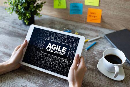 Agile development concept on the device screen. Banco de Imagens