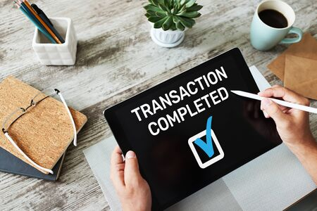 Transaction completed message on screen. Digital banking and online payment concept.