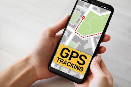 GPS tracking map on smartphone screen.  Global positioning system, navigation concept. Banco de Imagens